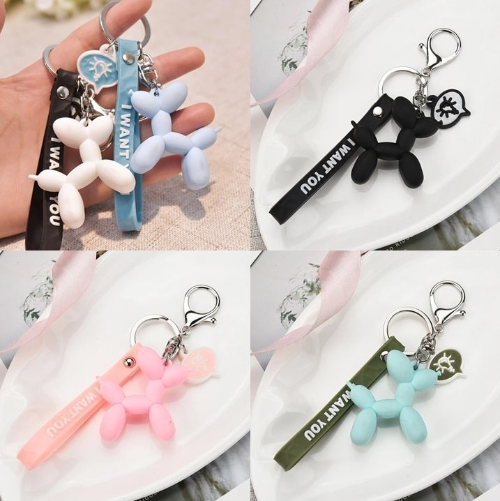 Image of four balloon Poodle keychains in different colors - blue, pink, white, black and green color