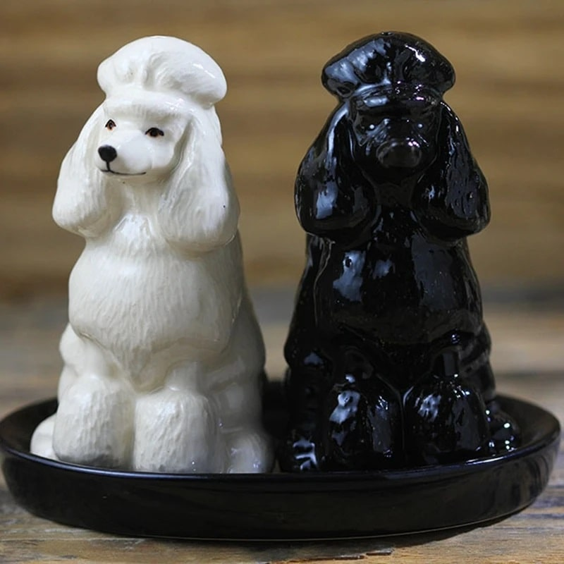 Image of two salt and pepper shakers in the shape of white and black poodle