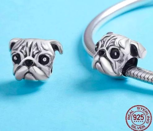 Image of two silver charm bracelets in the shape of a cute Pug's face