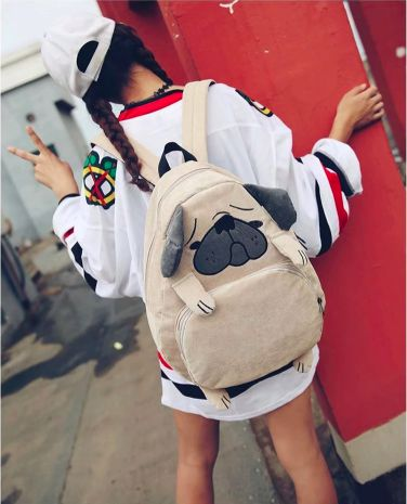 Image of a girl from behind wearing a cute Pug shaped backpack accessory