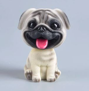 Image of a Shaking head car Bobble Head in the shape of a sitting cute pug with tongue sticking out