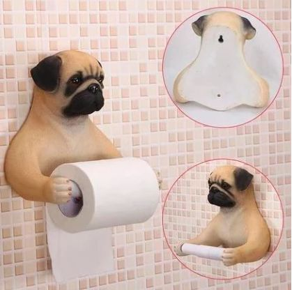 Image of a toilet roll holder in the shape of a pug with the arms stretched out holding the tissue paper roll