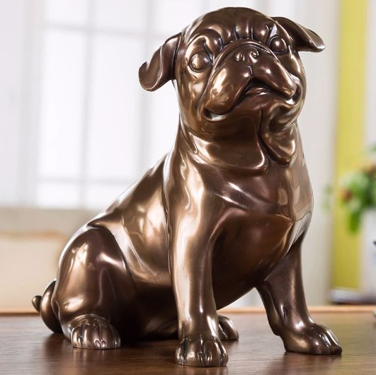 Image of a home decor sculpture in the shape of a bronze pug sitting