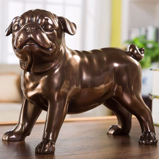 Image of a home decor sculpture in the shape of a bronze pug standing