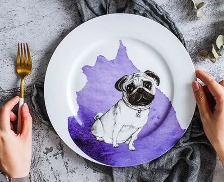 Image of a dinner plate with a cute Pug design printed on top