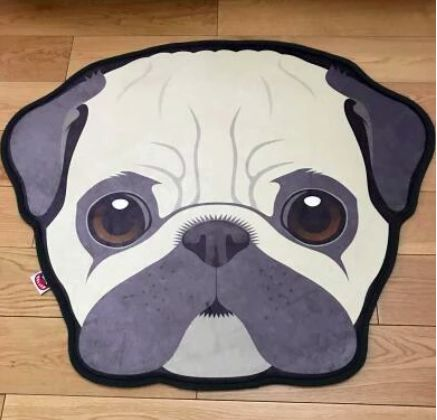Image of an indoor floor rug int he shape of a cute Pug face