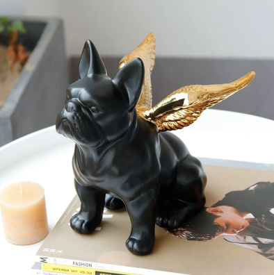 Image of a black French Bulldog home decor ornament with golden angel wings