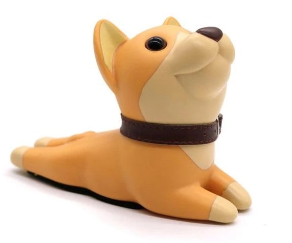 Image of an orange color door stopper in the shape of a shiba inu