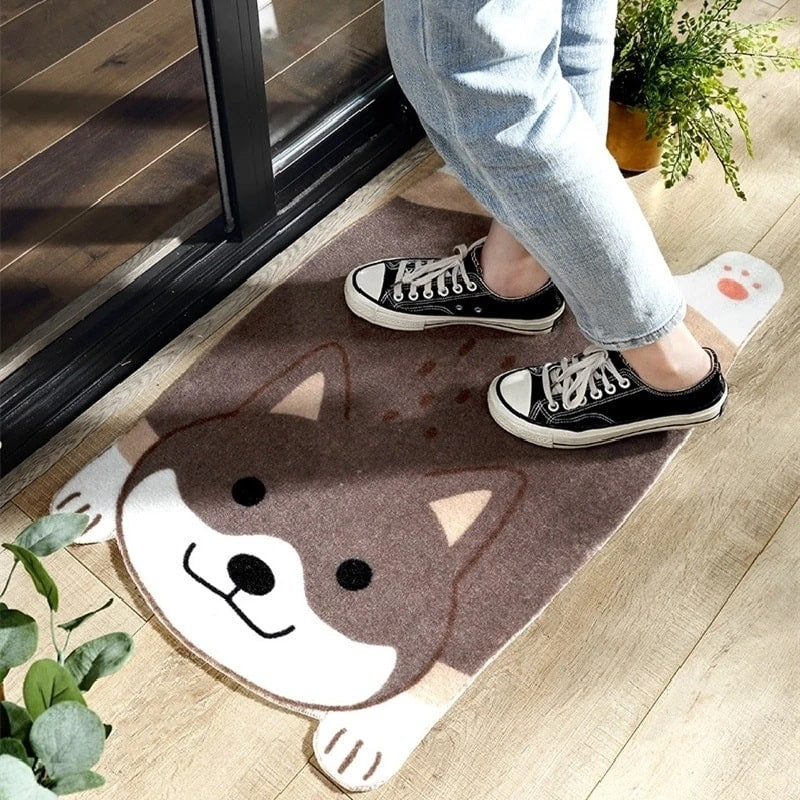 Image of a most adorable doormat on the floor in the shape of a Shiba Inu