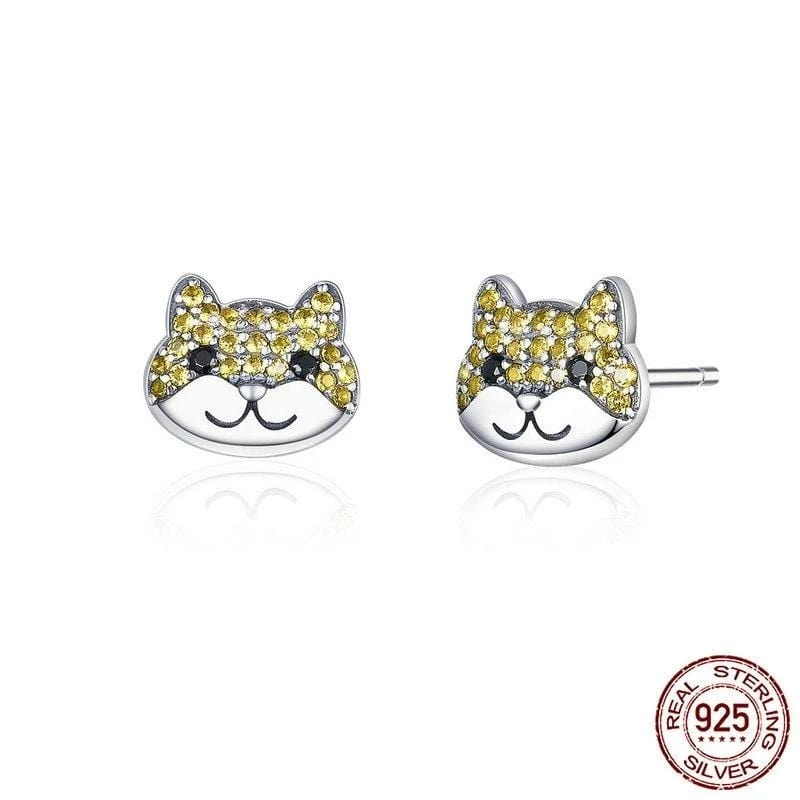 Image of a pair of Shiba Inu silver earrings in the shape of a Shiba Inu made of cubic zirconia and high quality 925 sterling silver