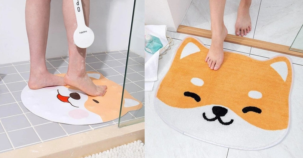 Image of two super cute bathroom mats on the floor in the shape of smiling Shiba Inu
