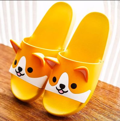 Image of a pair of orange flip flop slippers with a cute smiling Shiba Inu design