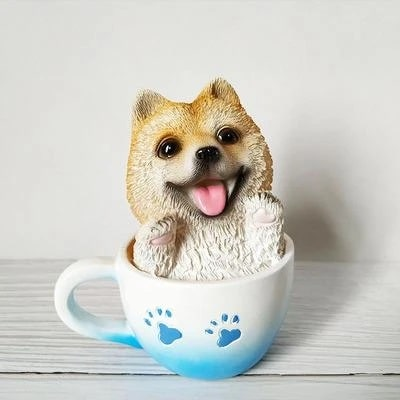 Image of a smiling Shiba Inu ornament made of resin, sitting in a teacup