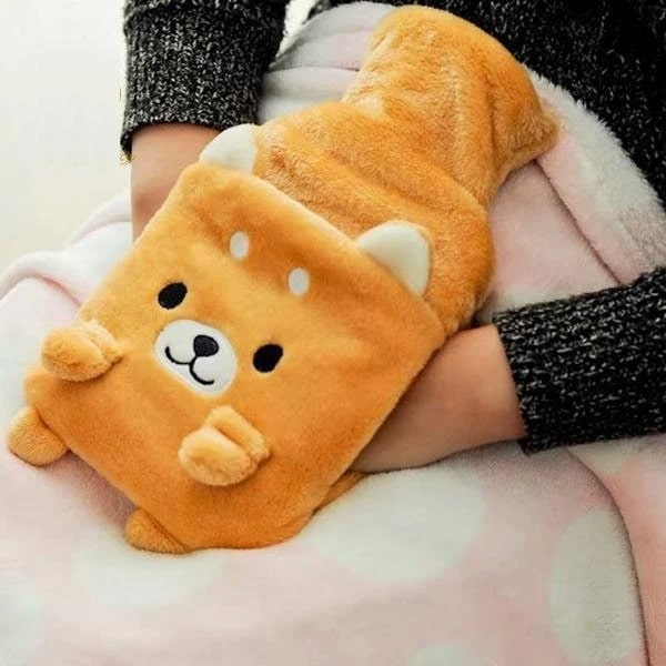 Image of a girl's hands in an orange hot water bottle in the shape of a Shiba Inu dog