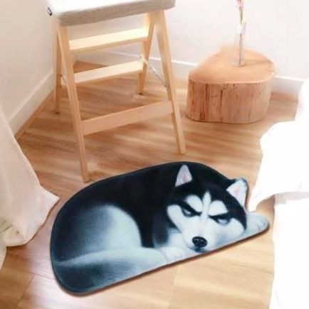 Image of a floor rug on a wooden floor in the shape of a sleeping Siberian Husky