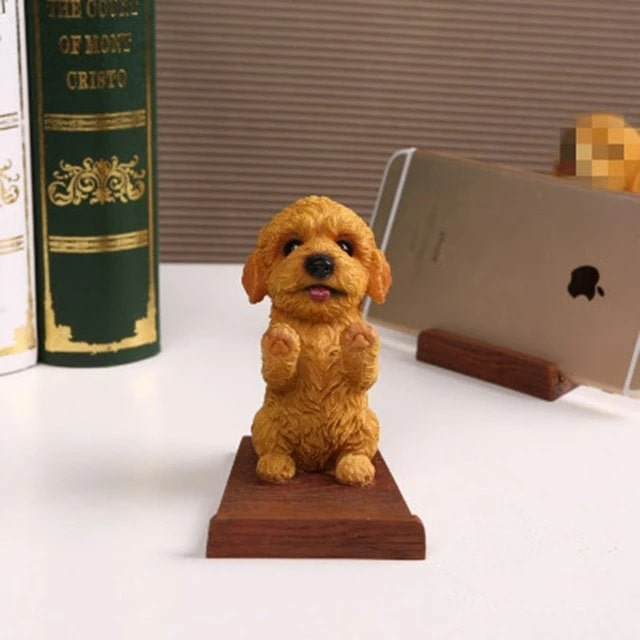 Image of a cell phone holder made of resin and wood in the shape of a Toy Poodle / Cockapoo / Goldendoodle, Labradoodle