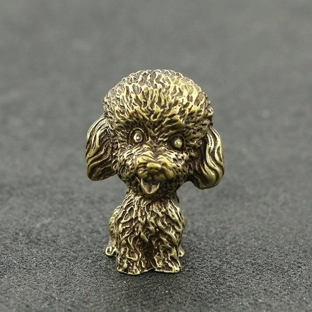 Image of a brass figurine in the shape of Toy Poodle