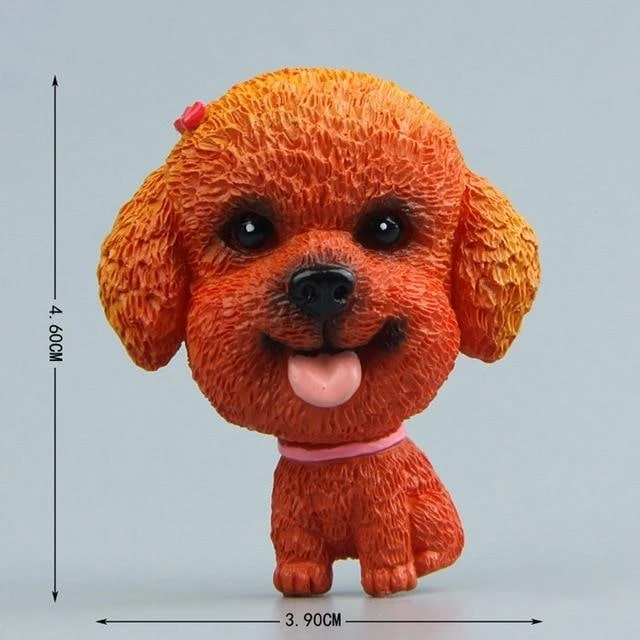Image of a fridge magnet which looks like a cute Toy Poodle with a super big face