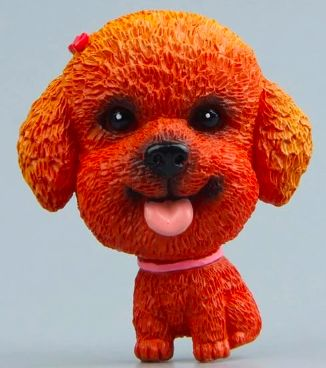 Close up image of a fridge magnet which looks like a toy poodle