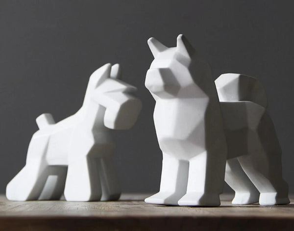 Image of Schnauzer statue and Samoyed statue in white color made of ceramic