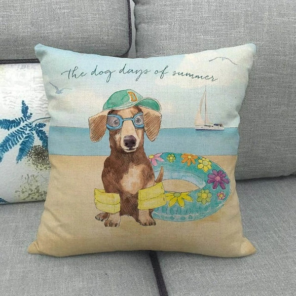 Image of a Dachshund print cushion cover at the beach design with the text written 'Dog Days of Summer', made of Linen / Cotton