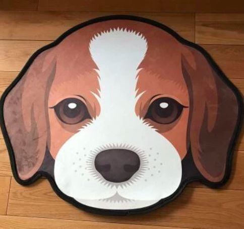 Image of a floor rug on a wooden floor in the shape of a cute Beagle dog's face