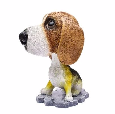 Image of a car bobble head in the shape of a sitting Beagle dog on a white background