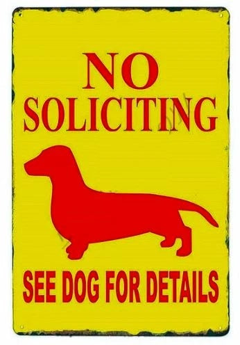Image of a tin poster with a similar dachshund and text which says 'No Soliciting - See Dog For Details''