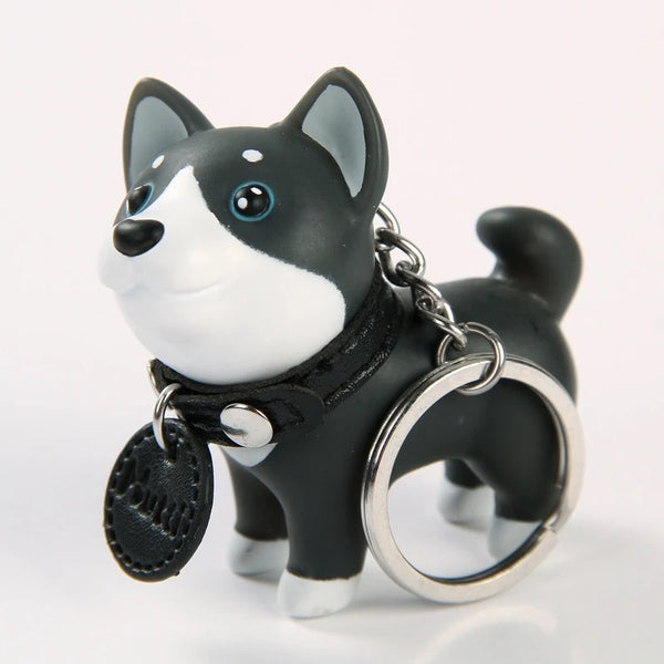 Image of a husky keychain in black color with 3D blue eyed husky design, made of PVC