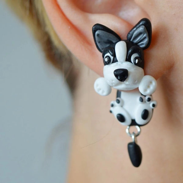 Image of a earring in the shape of a boston terrier, handmade with polymer clay