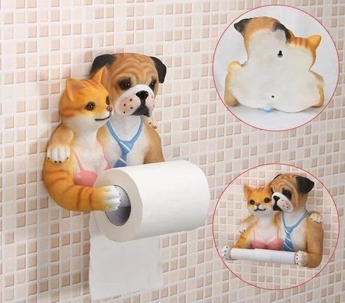 Image of a toilet roll holder in the shape of an english bulldog and cat with arms holding the tissue paper roll