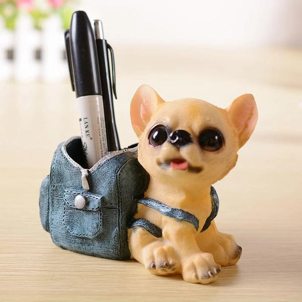 Image of a pen or pencil holder in the shape of a Chihuahua dog wearing a blue backpack