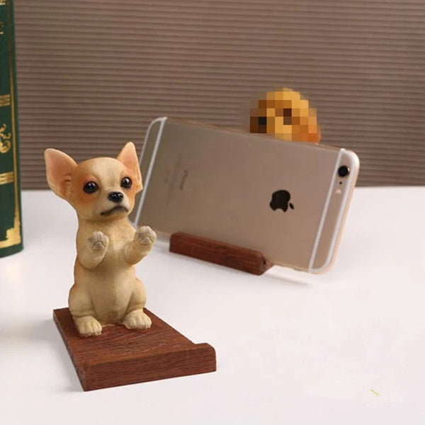 Image of a cell phone holder made of resin and wood in the shape of a chihuahua