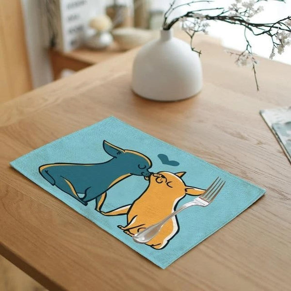 Image of a table mat on the table in the shape of two chihuahuas kissing in orange and blue color, made of 100% Linen