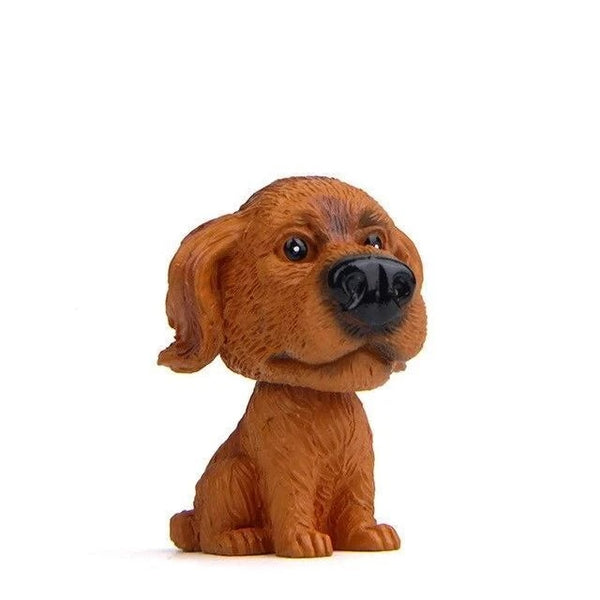 Image of a bobble head accessory in the shape of a golden retriever in dark coat made of resin