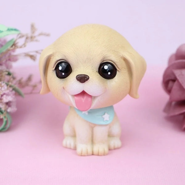 Image of a bobble head accessory in the shape of a golden retriever with big beady eyes, made of resin