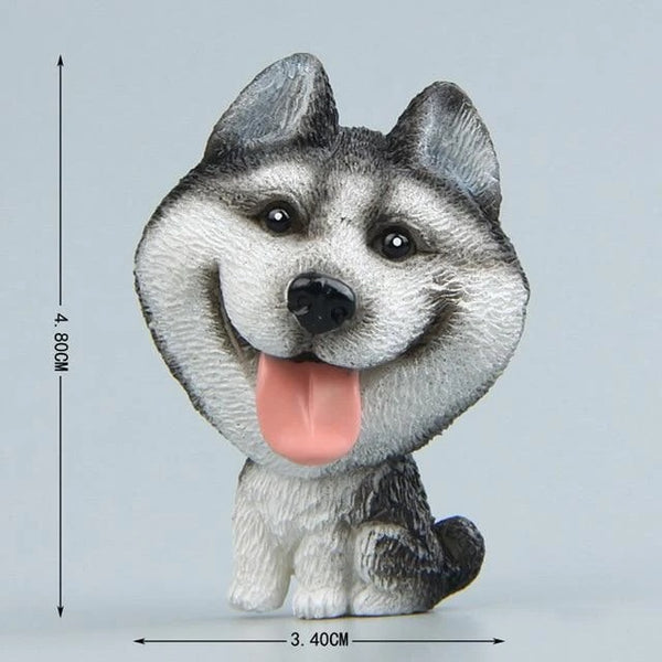 Image of a fridge magnet which looks like a cute sitting husky with a super big face