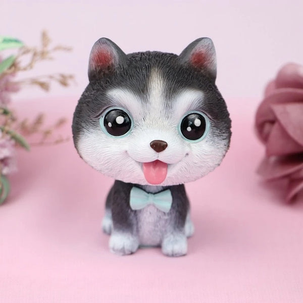 Image of a husky miniature bobblehead with big beady eyes, made of resin