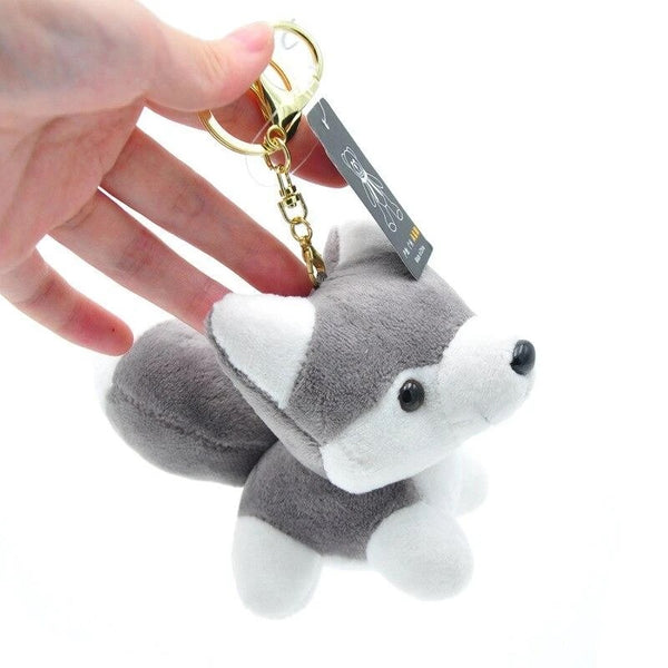 Image of a plush husky keychain in the shape of husky, made of cotton