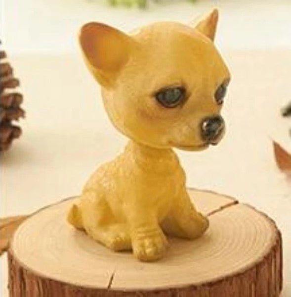 Image of a sitting bobblehead accessory in the shape of a chihuahua, made of Resin