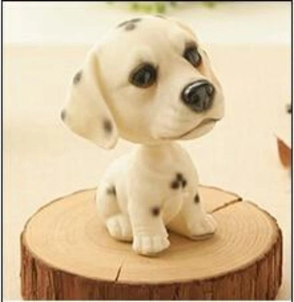 Image of a sitting bobblehead accessory in the shape of a dalmatian, made of Resin