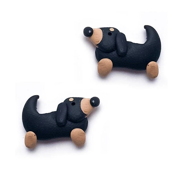 Image of two adorable earrings in the shape of dachshund, handmade with polymer clay