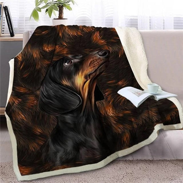 Image of a blanket spread out on a couch with a black Dachshund design