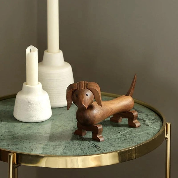 Image of a wooden dachshund statue sitting on a table amde of Walnut Solid Wood Material