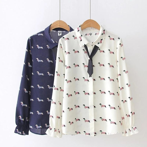 Image of two shirts hanging in the color white & navy blue with a cute infinite Dachshund dog print