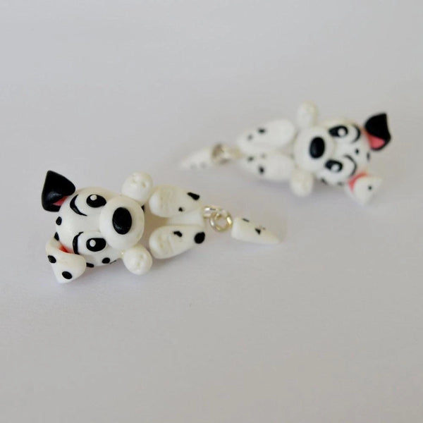 Image of two dalmatians polymer clay earrings in the shape of dangling dalmatian