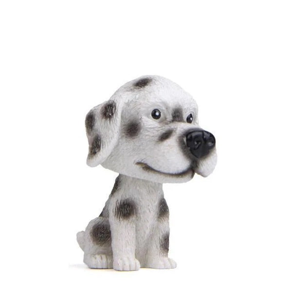 Image of a miniature bobblehead accessory in the shape of a dalmatian, made of resin