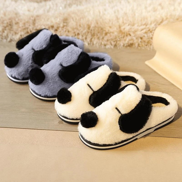 Image of two warm indoor dalmatian slippers in the color light blue and white made of flock upper, soft plush lining and rubber outsole