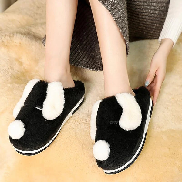 Image of warm indoor dalmatian slipper in the color black, made of flock upper, soft plush lining and rubber outsole