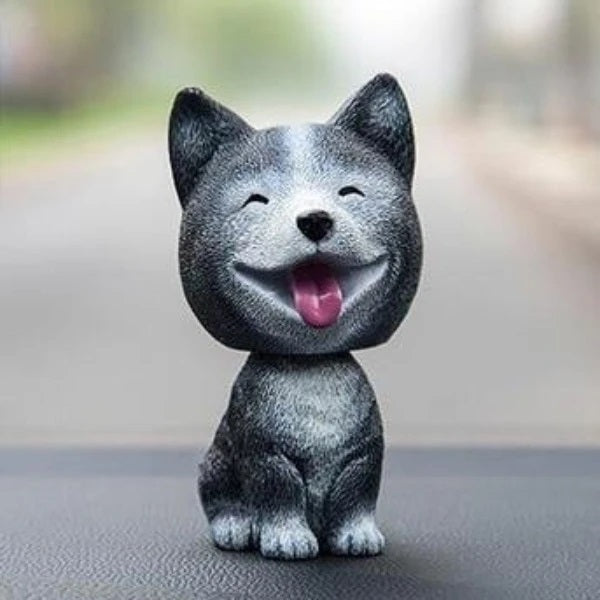 Image of a smiing siberian husky car bobblehead made of resin